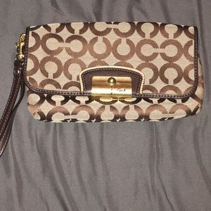 New COACH signature design clutch
